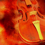 Red violin. Against an explosive background Stock Photo