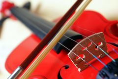 Red Violin. Closeup picture of bridge and string of a red violin royalty free stock photo