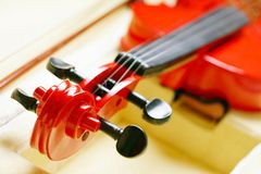 Red Violin. Closeup picture of scroll and pegbox of a red violin stock images