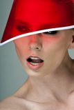 In a red visor. Fashion portrait of model in a red visor Royalty Free Stock Photos