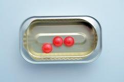 Red vitamin pill Royalty Free Stock Photos