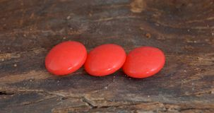 Red vitamin pill Royalty Free Stock Images