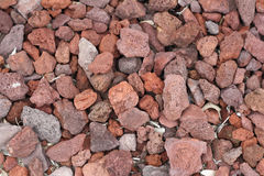 Red Volcanic Rocks Ground Cover. Many medium and small volcanic red rocks all together on the ground being used as ground cover. Red volcanic rocks ground cover stock photos