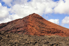 Red volcano with solidified lava in the foreground Stock Photography