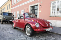 Red Volkswagen Beetle. On a city street Royalty Free Stock Images