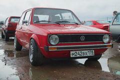 Red Volkswagen Golf the first generation on the retro car show in Kronstadt Stock Photography