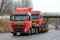 Red Volvo FH Exceptional Transport of Identical Truck stock images
