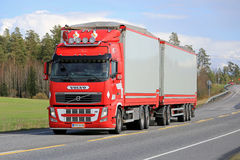 Red Volvo FH Full Trailer Truck on the Road Stock Photo