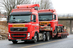 Red Volvo FH Hauls Identical Truck royalty free stock image