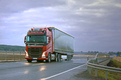 Red Volvo FH Semi and Dark Sky Stock Photo