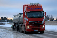 Red Volvo FH Tank Truck Delivers at Dusktime royalty free stock photos
