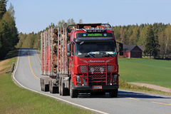 Red Volvo Logging Truck Transports Timber at Spring Stock Images