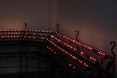 Votive candles in a church. Red Votive candles, burning in a dutch protestant Christian church stock images