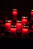 Red votive candles with burning flame. Many red votive candles with burning flame Stock Image