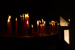 Red Votive Prayer Candles Burning in Church Royalty Free Stock Photos