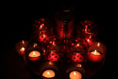 Red votives and candles Royalty Free Stock Photo