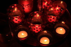 Red votives and candles Stock Photography