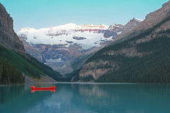 Red Voyageur Canoes on Lake Louise at Dawn Royalty Free Stock Image
