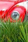 Red vw beetle. Vintage red vw beetle detail Stock Photo