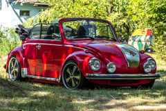 Red VW Beetle Cabrio. Red VW Cabrio with the image of the Fokker DR-1 Triplane on the hood Stock Photo