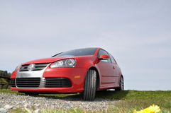 Red VW Golf R32. A red Volkswagen 3.2 liter VE6 all wheel drive Golf R32 Royalty Free Stock Photos