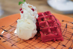 Red waffles with vanilla ice cream and whipped cream Stock Image
