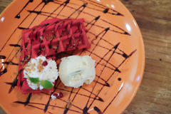 Red waffles with vanilla ice cream and whipped cream Royalty Free Stock Photo