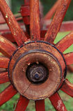 Red Wagon Wheel. Close-up of a red wooden wagon wheel Royalty Free Stock Photography