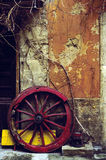 Red Wagon Wheel & Wall Royalty Free Stock Photography