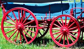 Red Wagon Wheels. On an old covered wagon Stock Image