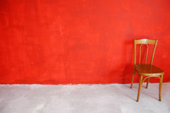 Red wall. A chair before the red wall Royalty Free Stock Photos