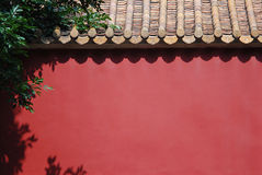 Red wall. In the sun Stock Photography