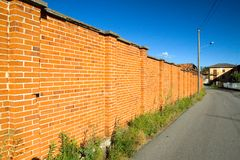 Red wall. Under deep blue sky royalty free stock photo
