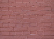 Red wall background. A rough red wall of bricks texture Royalty Free Stock Image