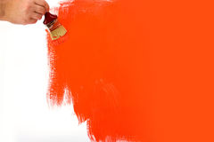 Red wall being painted Stock Image