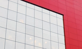 Red wall with big white window of modern shopping center Royalty Free Stock Image