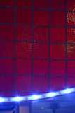Red wall and blue light Royalty Free Stock Photo
