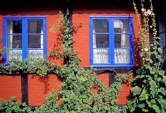 Red wall and blue windows Royalty Free Stock Photos
