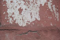 The wall is cracked painted. Seen cement base. Can use for background royalty free stock images