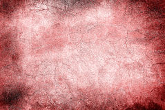 Red wall with cracks Stock Images