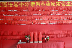 Red wall full of red praying papers. Red praying wall full of pasted red buddahistic praying papers Royalty Free Stock Images