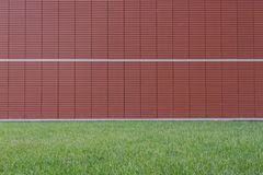Red wall, green garden Stock Image