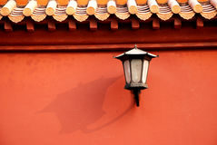 Red wall and lamp. Chinese ancient imperial red wall and old styled lamp,with yellow tiles Royalty Free Stock Image