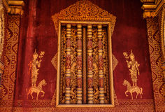 Red wall in Luang Prabang Stock Photography