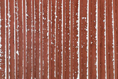 Red wall made of wood covered with snow Stock Images