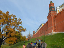 Red Wall Moscow. MOSCOW, RUSSIA - OCTOBER 20, 2012: Tourists visiting the Red Wall of The Kremlin in Red Square Royalty Free Stock Image