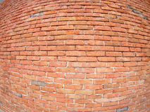 Red wall of an old brick. By wide angle fisheye view royalty free stock photo