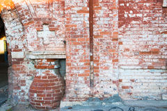 The red wall of an old building Stock Photo