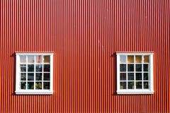 Red wall and two windows Stock Images