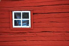 Red wall with window. Vintage wooden red wall with small window Royalty Free Stock Images